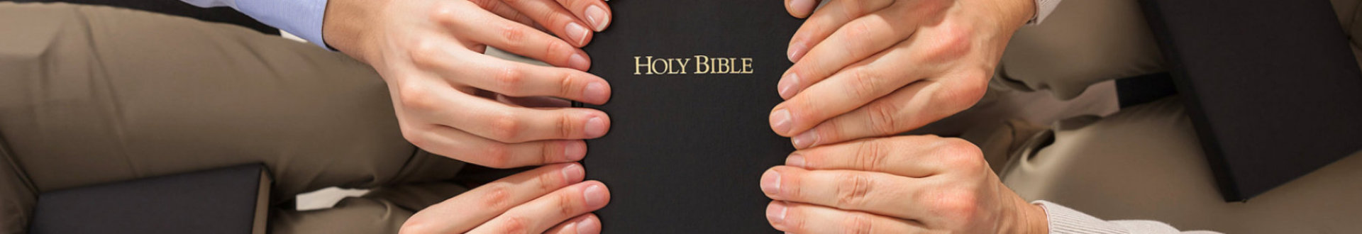 people holding a bible
